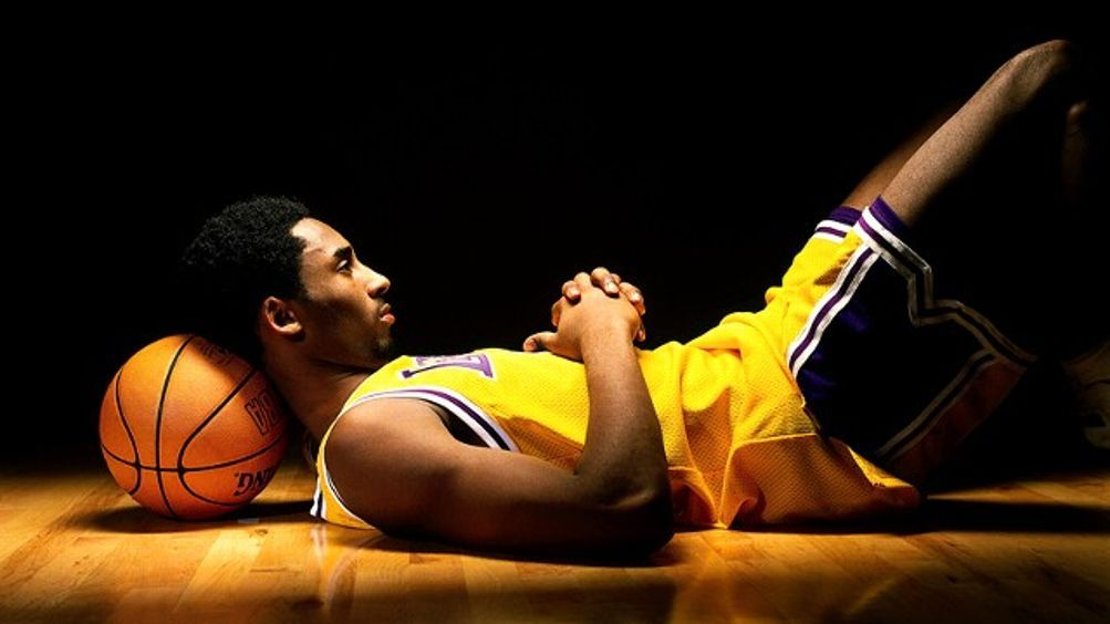 Kobe Bryant Laying down with Ball